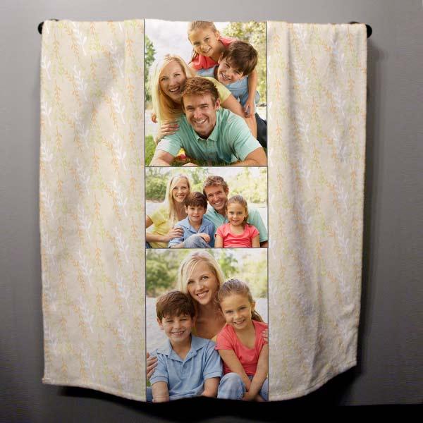Custom family bath towel with photos hanging on display
