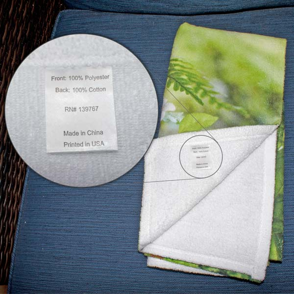 Close up image of Custom photo towel with tag