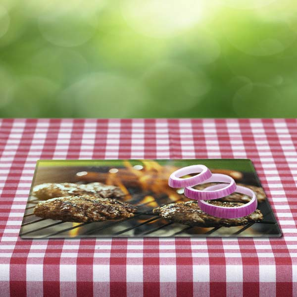 Show off your photo during a summer cookout with a personalized glass cutting board