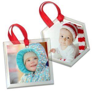 Display a favorite photo on one of our stylish clear glass ornaments for a unique look this holiday.