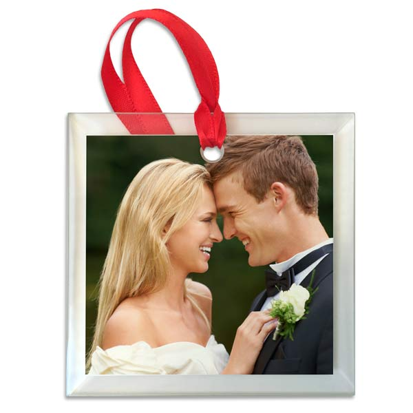 Add a crystal-like shine to your Christmas tree with our custom photo glass ornament.