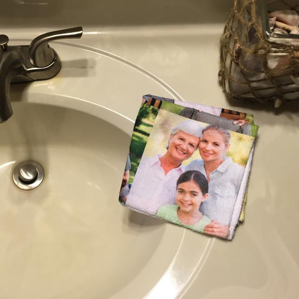 Photo Collage wash cloth on display by a powder room sink