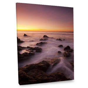 Our stunning canvas print showcases the ocean at dusk for added elegance to your decor.