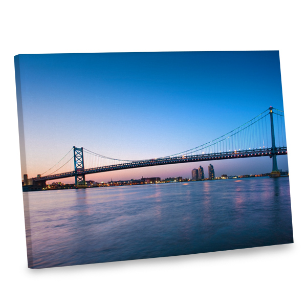 With its stunning sunset colors, our bridge at dusk canvas will add intrigue to your home decor.
