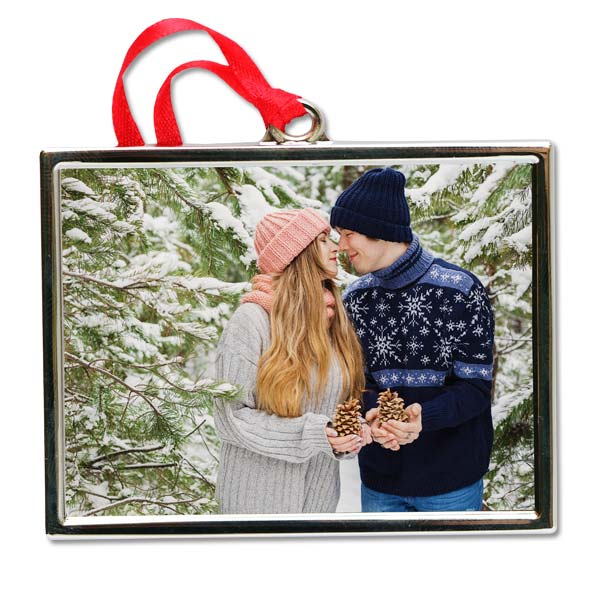 Create a quality silver frame ornament with your favorite picture to commemorate the holiday