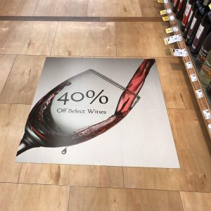 Create a floor advertisement to stick almost anywhere in your store