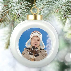 Add your photo to a holiday ball ornament and hang it from your tree