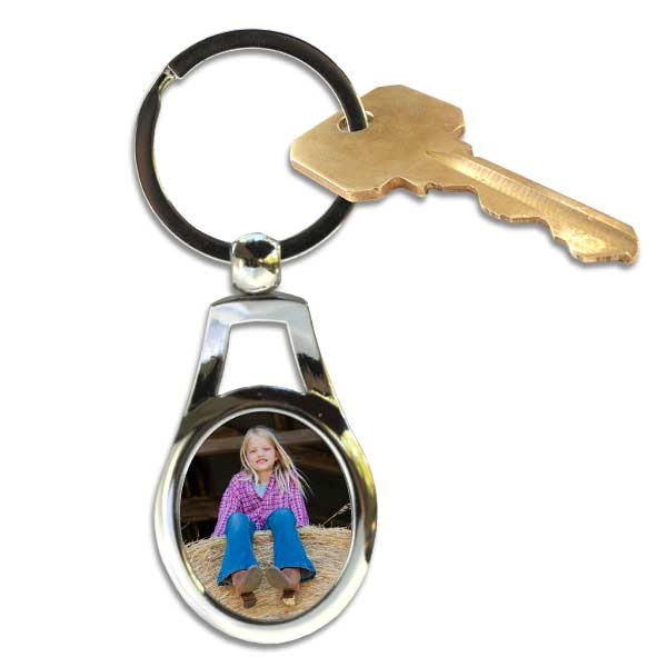 Create a quality metal oval key ring with a photo of your choosing.