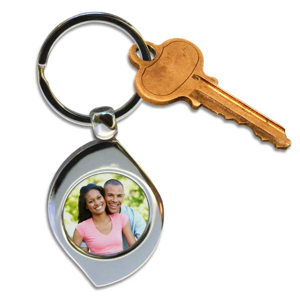 personalize your own swirl or teardrop key ring by adding your favorite picture
