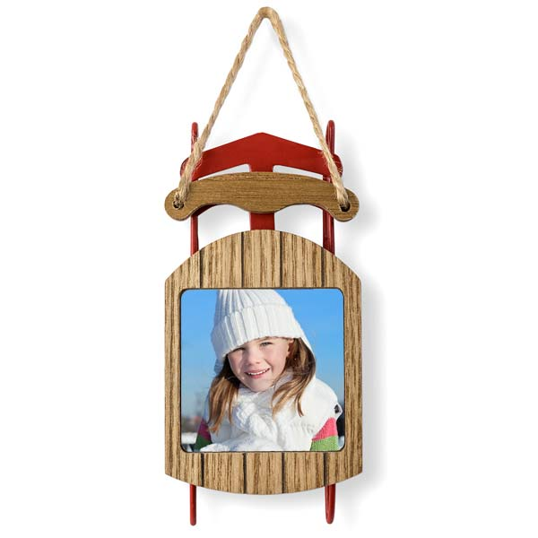 Add your picture to a beautiful sled ornament that will look beautiful on your tree